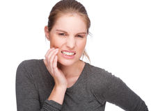 Toothache. Full isolated studio picture from a young woman with toothache Stock Image