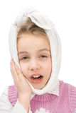 Toothache. Little girl with a warming shawl around her head having toothache Stock Photography
