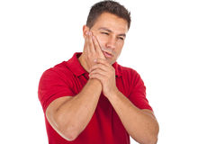 Toothache. Young man suffering from toothache Royalty Free Stock Images