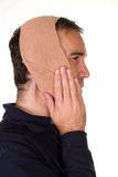 Toothache. Profile view of a man weaing a bandage for his tooth pain Stock Photos