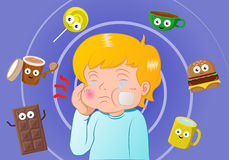 Toothache boy surrounding by sweet meal Stock Photo