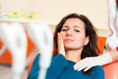 Toothache. Female patient in pain, having a toothache stock image