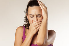 Toothache and headache. Sad young girl has a toothache and headache Royalty Free Stock Photo
