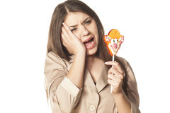 Toothache from lollipop Stock Photos