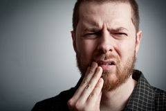 Toothache - man with teeth problems. Toothache - suffering young man with teeth problems Royalty Free Stock Image