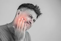 Toothache, medicine, health care concept, Teeth Problem, young m royalty free stock images