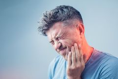 Toothache, medicine, health care concept, Teeth Problem, young m stock images