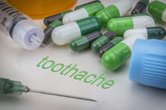 Toothache, medicines and syringes as concept. Of ordinary treatment health Royalty Free Stock Photos
