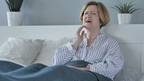 Toothache, Old Senior Woman with Tooth Pain Sitting in Bed. 4k , high quality stock footage