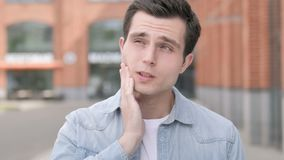 Toothache, Outdoor Portrait of Young Man with Tooth Pain. 4k high quality, 4k high quality stock video footage