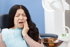 Senior woman suffering from toothache. Toothache! Senior woman having a terrible toothache visiting dentist copyspace pain hurting cavities dentistry dental royalty free stock image