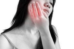 Toothache symptom in a woman isolated on white background. Clipp Stock Photo