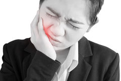 Toothache symptom in a woman isolated on white background. Clipping path on white background. Royalty Free Stock Image