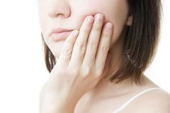 Toothache. Woman's face isolated white background royalty free stock images