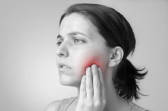 Toothache. A young woman having toothache stock photo