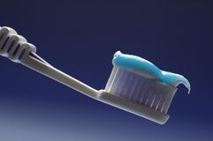 Toothbrush. Tooth brush in blue cup close up Royalty Free Stock Photo