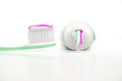 Toothbrush. A toothbrush with toothpaste in front of white background Stock Images