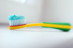 Toothbrush. And blue toothpaste for personal hygiene stock images