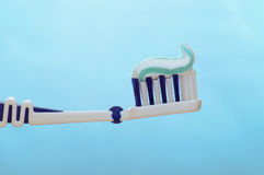 Toothbrush. On a blue background Stock Images