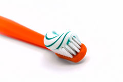 Toothbrush. Orange color toothbrush white background isolate royalty free stock photos