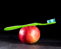 Toothbrush and apple Stock Images