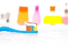 Toothbrush and bathroom bakcground Stock Image