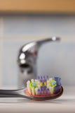 Toothbrush in bathroom on sink Royalty Free Stock Image