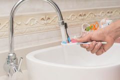 Toothbrush being washed Stock Photography