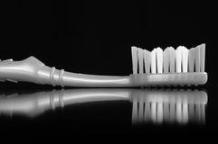 Toothbrush on Black Background Stock Images