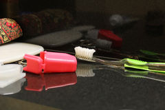 Toothbrush. On black bathroom counter Royalty Free Stock Photography
