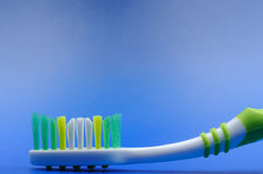 Toothbrush on a blue background Stock Photos