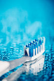 Toothbrush on blue background Royalty Free Stock Image
