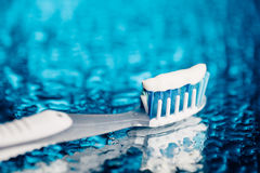 Toothbrush on blue background Stock Images