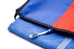 Toothbrush on blue towel Stock Photos