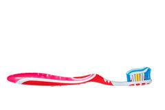 Toothbrush with blue two color toothpaste on light Stock Image