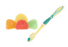 Toothbrush and Candy Stock Photos