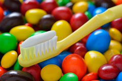 Toothbrush. On candy background stock photos