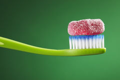 Toothbrush and candy Stock Photo