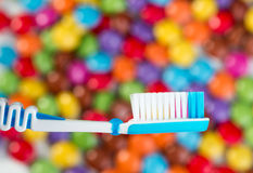 toothbrush and chocolate candies Royalty Free Stock Photos
