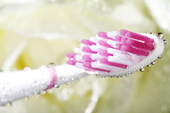Toothbrush closeup with water Royalty Free Stock Image