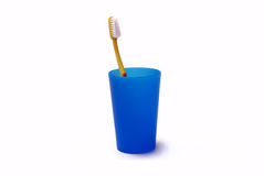 Toothbrush in a color holder. On white background Royalty Free Stock Photo