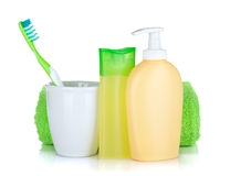 Toothbrush, cosmetics bottles and towel Royalty Free Stock Image