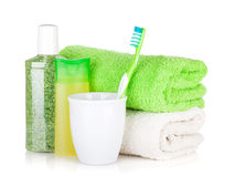 Toothbrush, cosmetics bottles and towels Stock Photography