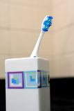 Toothbrush in the cup Stock Images