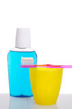 Toothbrush on Cup with Mouthwash Royalty Free Stock Photos