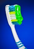 Toothbrush on a dark blue background Royalty Free Stock Images