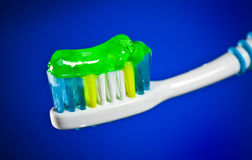 Toothbrush on a dark blue background Stock Images