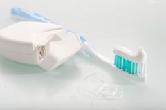 Toothbrush and dental floss Royalty Free Stock Images