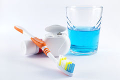 Toothbrush, dental floss, toothpaste and mouthwash on white background Royalty Free Stock Image