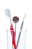 Toothbrush and Dental mirror - explorer in glass Royalty Free Stock Photography